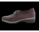 Zapatilla deportiva texturizada cuña baja burdeos